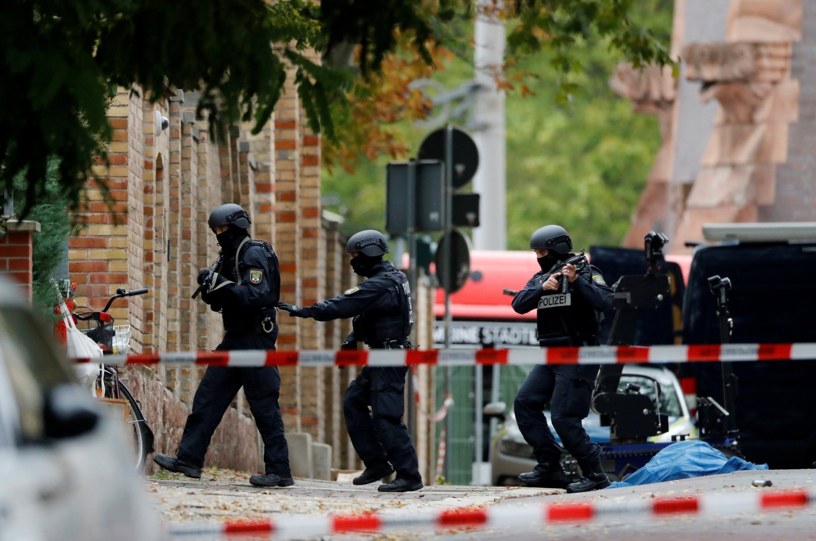 Police officers work at the site of a shooting, in which two people were killed, in Halle, Germany October 9, 2019. (Reuters Photo)