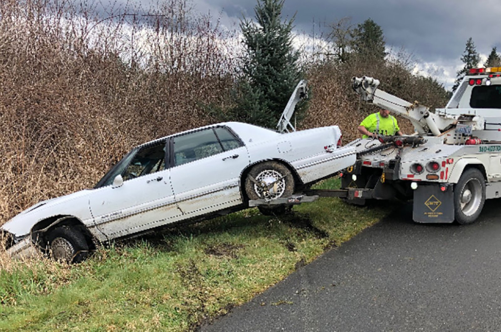 This handout image courtesy of the Washington State Patrol taken by Sgt. Keith Leary shows a car being towed after a high-speed pursuit south of Seattle, Washington, Sunday, March 29, 2020. (AFP Photo)