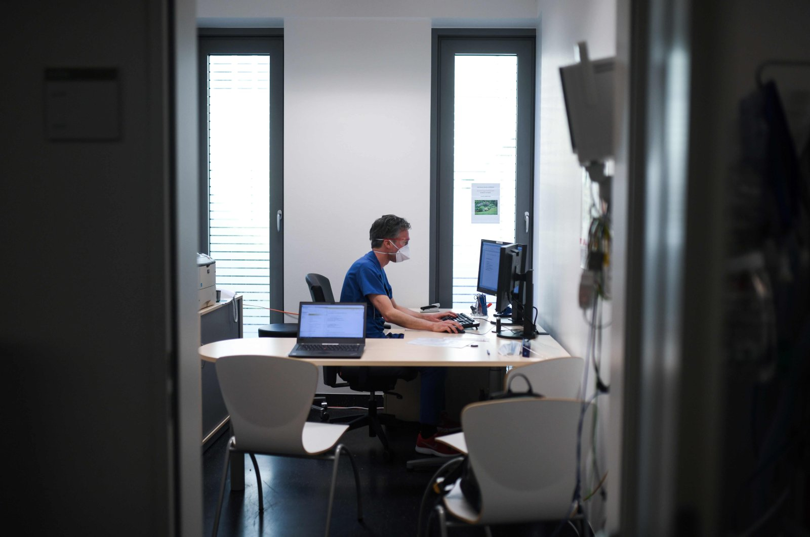 Doctor David Fistera works in his office at the central reception center for corona cases at the University hospital in Essen, western Germany, on March 26, 2020. (AFP Photo)