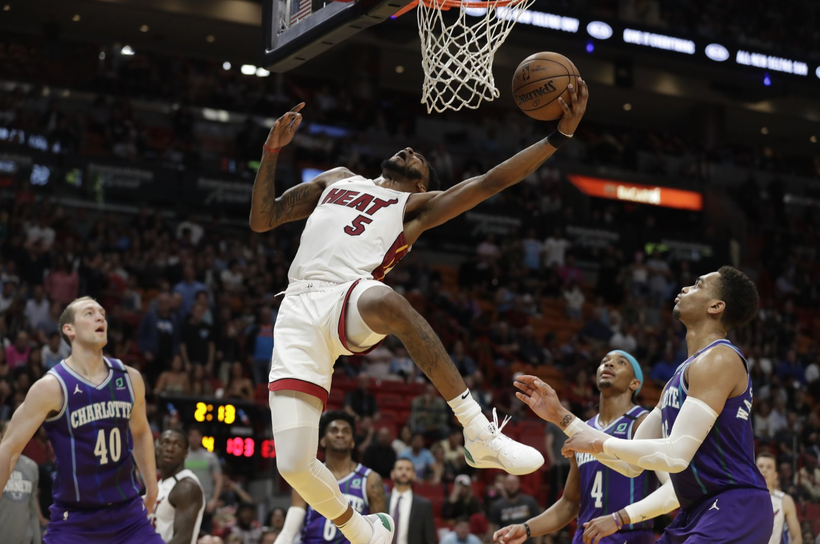 Miami Heat forward Derrick Jones Jr. (5) goes up for a shot during the second half of an NBA basketball game against the Charlotte Hornets, in Miami, March 11, 2020. (AP Photo)