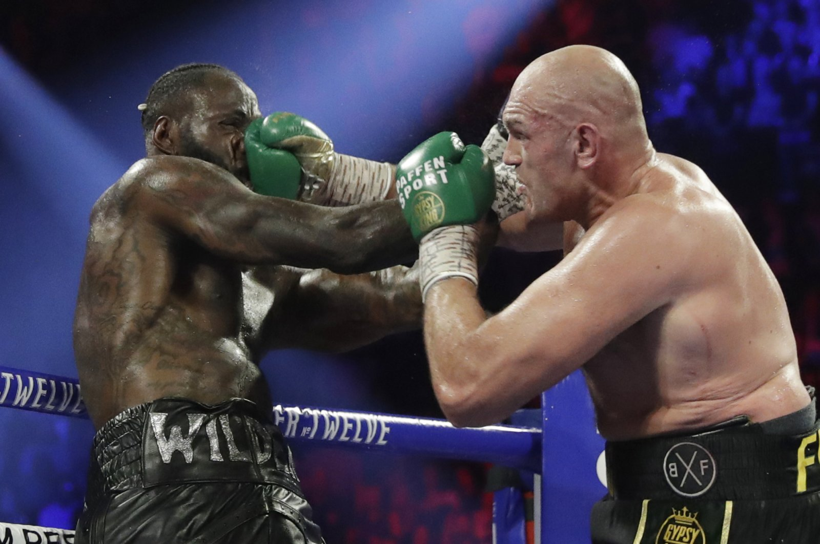 Tyson Fury lands a right to Deontay Wilder during a WBC heavyweight championship match in Las Vegas, Feb. 22, 2020. (AP Photo)
