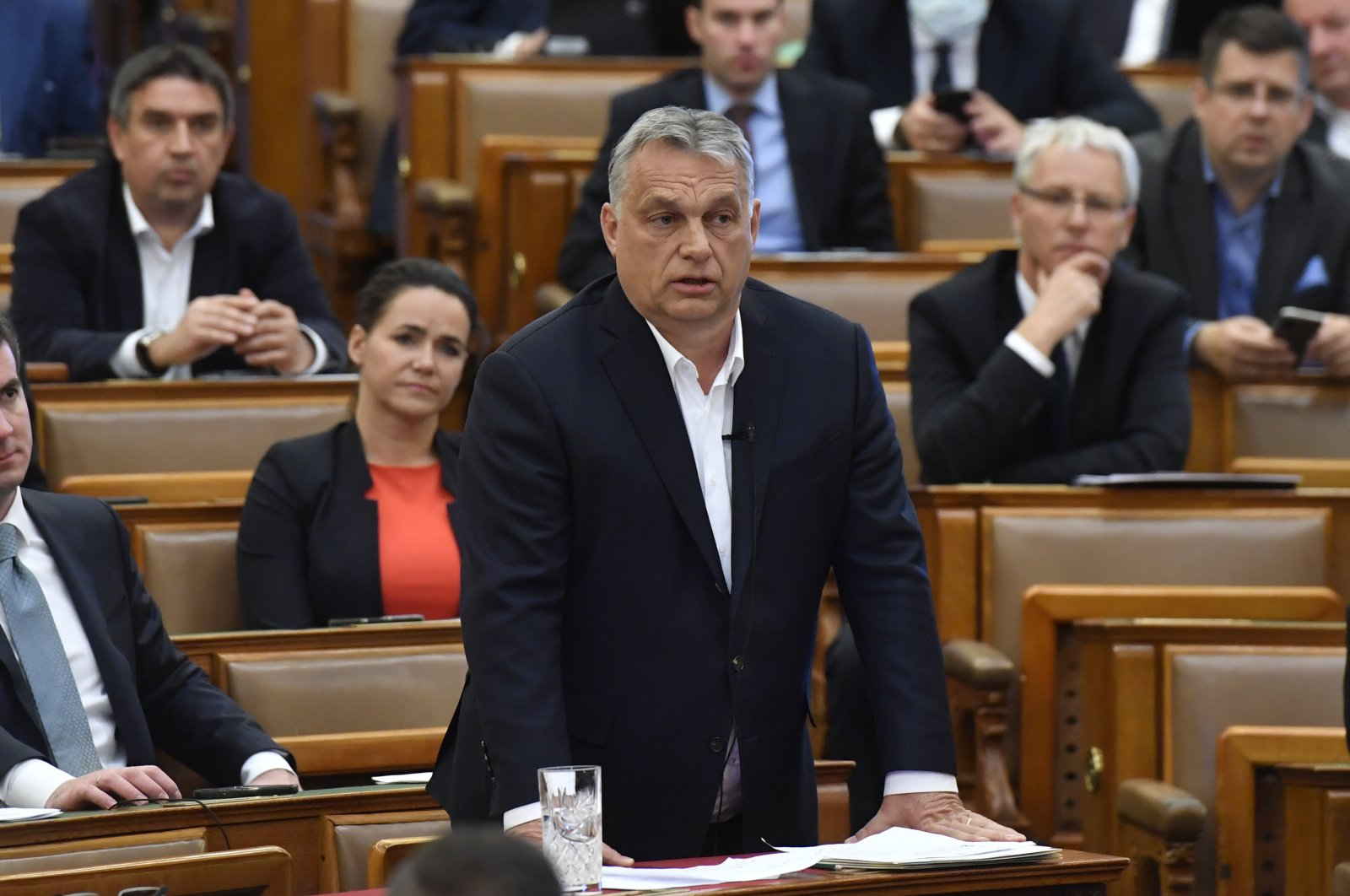 Hungarian Prime Minister Viktor Orban replies to an oppositional MP during a question and answer session of the Parliament in Budapest, Hungary, Budapest, Hungary, Monday, March 30, 2020. (AP Photo)