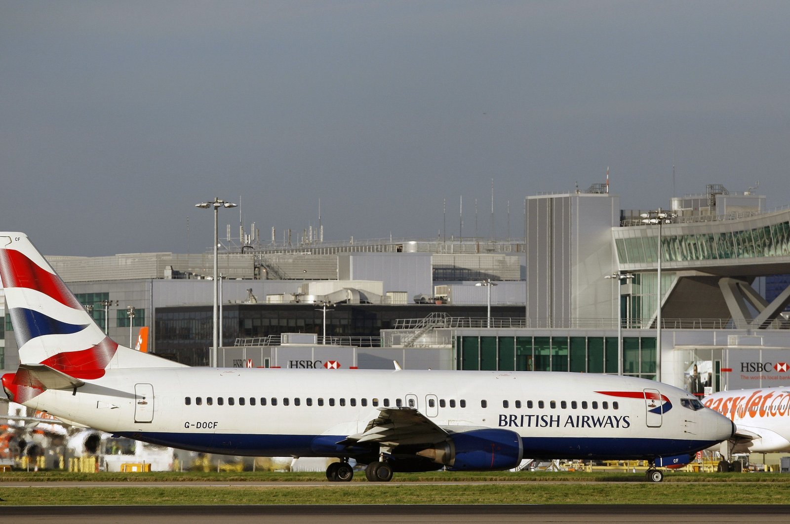 This file picture taken on November 19, 2008 shows a British Airways passenger jet along the apron at London Gatwick Airport near Crawley, southern England. (AFP Photo)