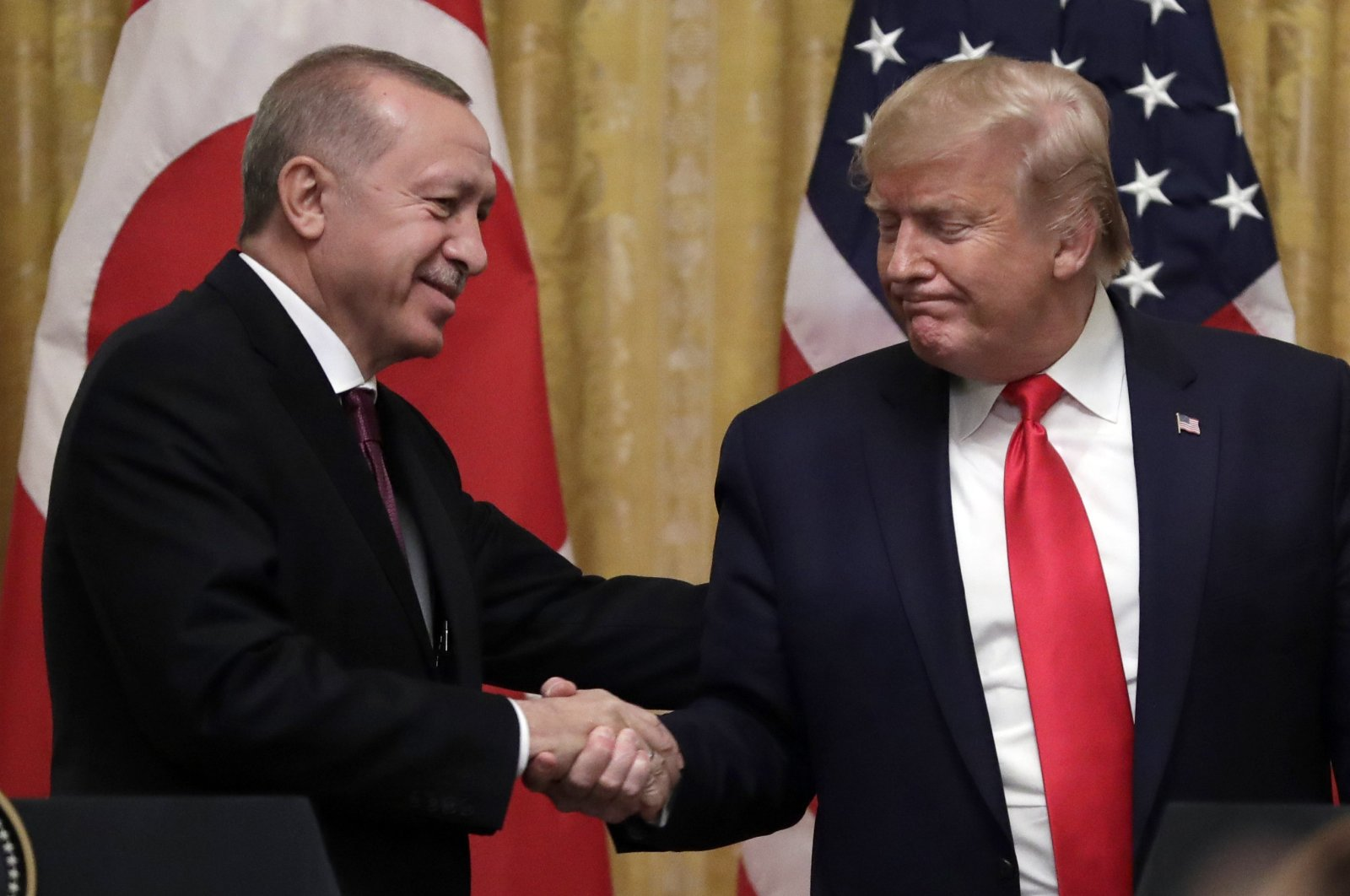 President Recep Tayyip Erdoğan shakes hands with U.S. President Donald Trump after a news conference in the East Room of the White House, Nov. 13, 2019. (AP Photo)