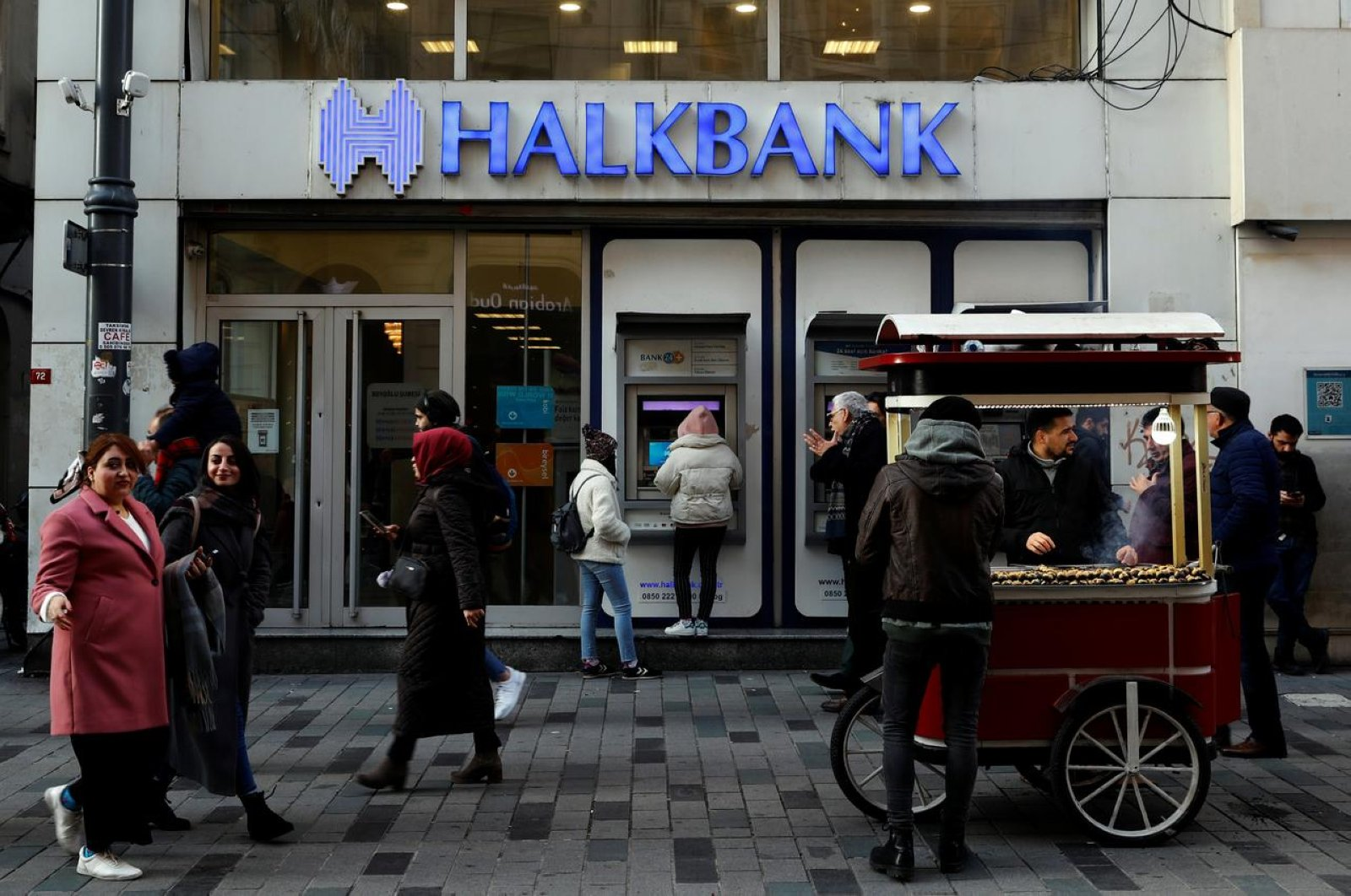 People walk past by a branch of Halkbank in central Istanbul, Turkey, January 22, 2020. (Reuters Photo)