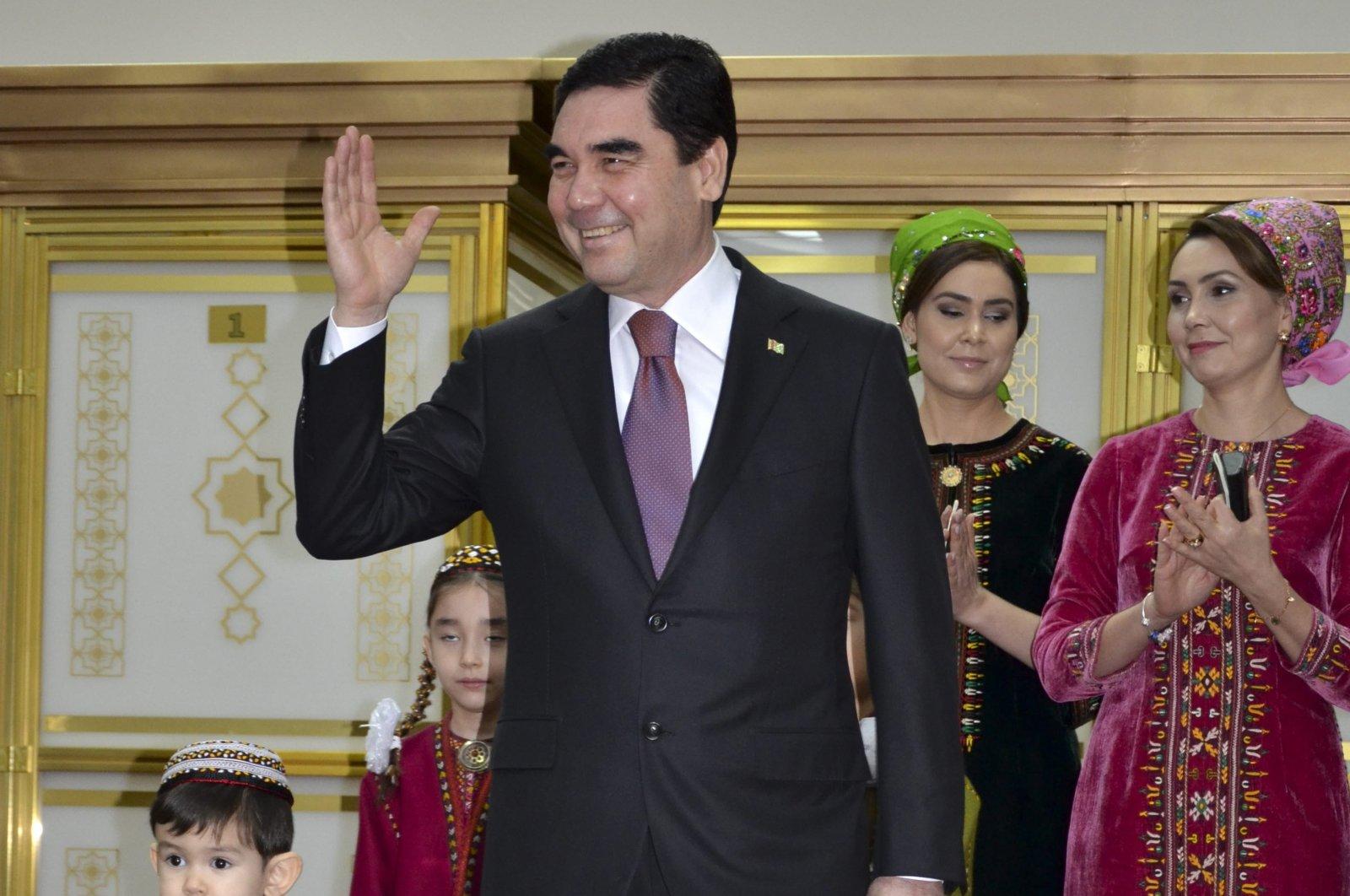 Turkmenistan President Gurbanguly Berdimuhamedov, center, greets journalists after casting his ballot at a polling station in Ashgabat, Turkmenistan, Sunday, Feb. 12, 2017. (AP Photo)