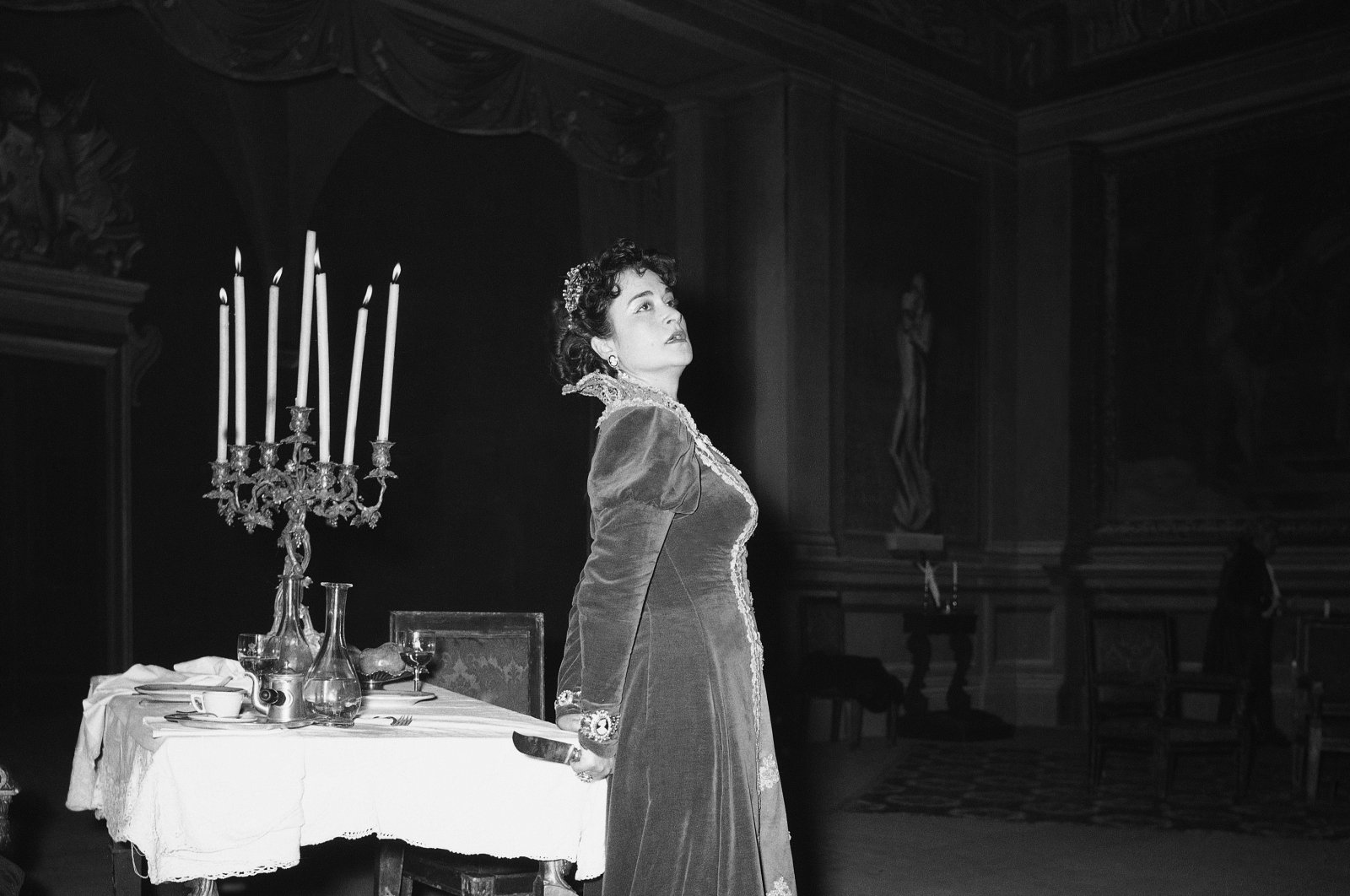 """Turkish soprano Leyla Gencer is shown at a dress rehearsal of Puccini's """"Tosca"""" at the San Carlo Opera House in Naples, Italy, Jan. 20, 1955. (AP Photo)"""
