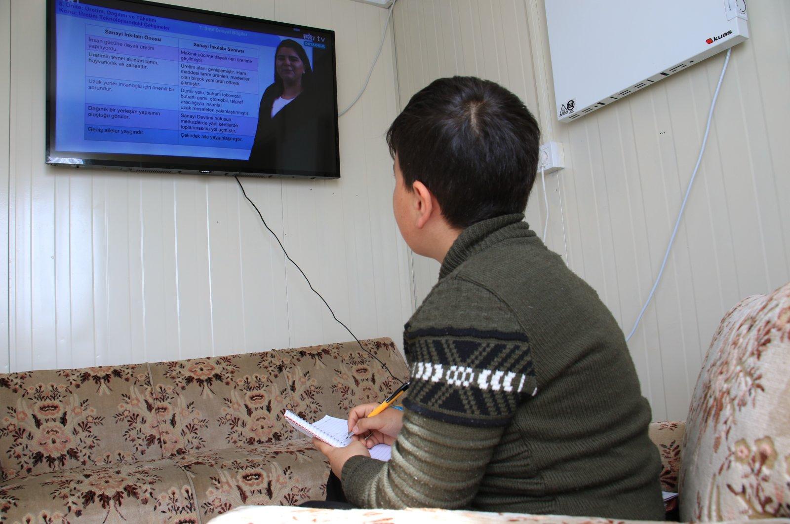 A boy watching a pre-recorded lesson on TV, Elazığ, Turkey, Wednesday, April 1, 2020. (İHA Photo)
