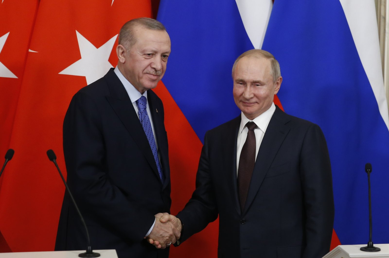 This file photo dated March 5, 2020 shows President Recep Tayyip Erdoğan (L) and his Russian counterpart Vladimir Putin shake hands following a summit on Idlib in Moscow. (AA Photo)