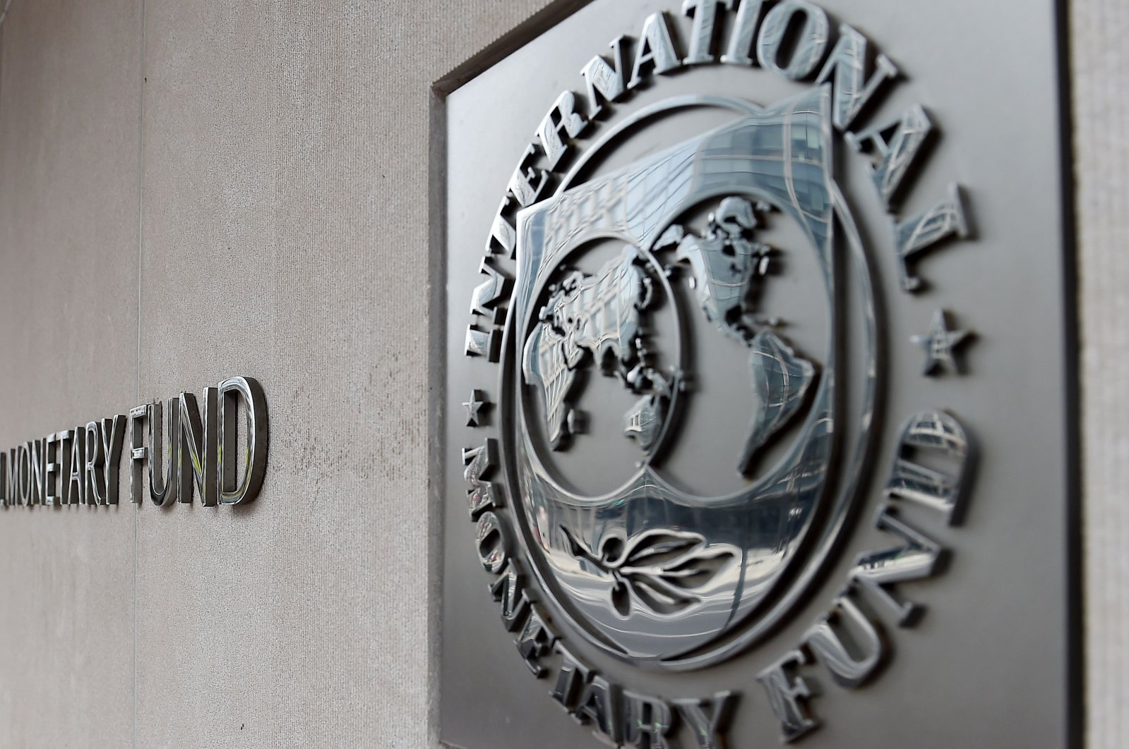 In this file photo an exterior view of the building of the International Monetary Fund (IMF), with the IMF logo, is seen on March 27, 2020 in Washington, D.C. (AFP Photo)