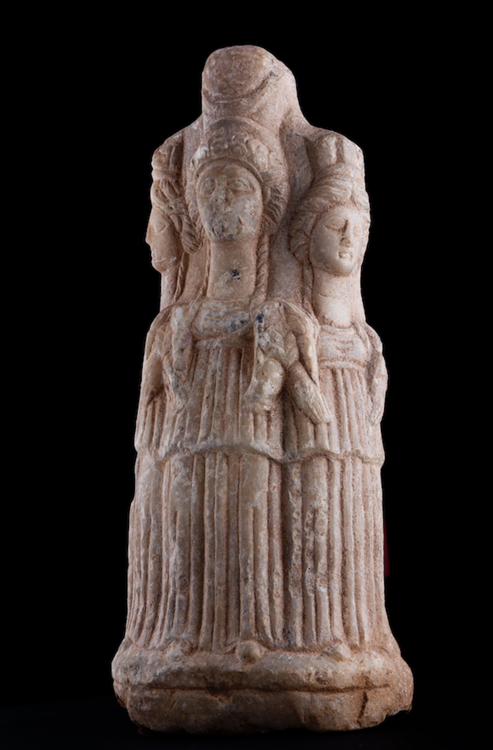 Depicted as three-faced, the statue of Hecate is made of marble.