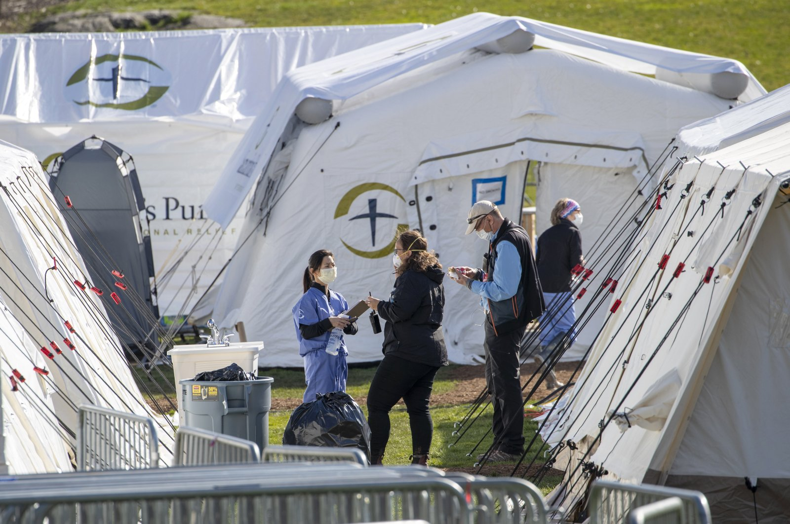 Medical personnel work at the Samaritan's Purse field hospital in New York City's Central Park, Wednesday, April 1, 2020. (AP Photo)