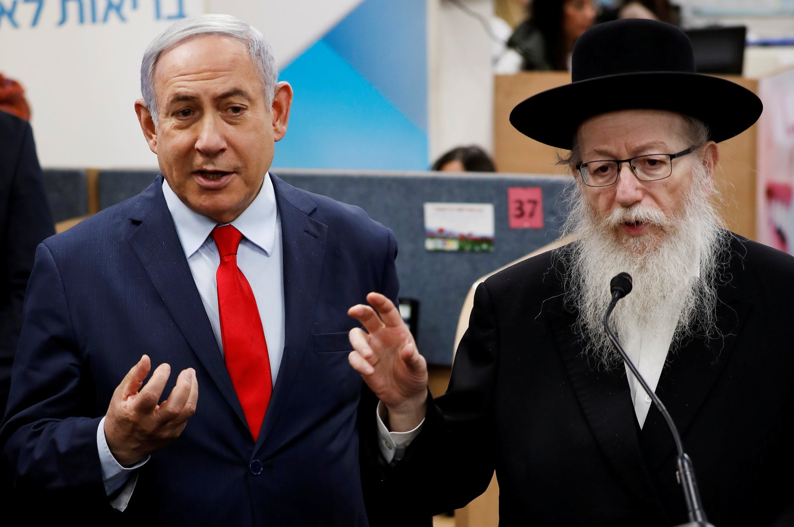 Israeli Prime Minister Benjamin Netanyahu (L) and Health Minister Yaakov Litzman gesture as they deliver statements during a visit to the Health Ministry national hotline, in Kiryat Malachi, Israel, March 1, 2020. (Reuters Photo)
