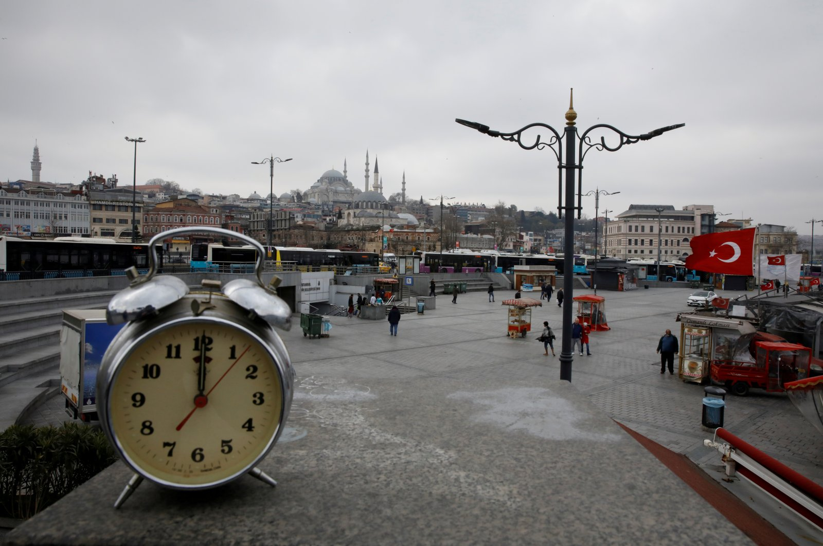A clock showing the time at noon, is displayed for a photo at Eminonu district during the coronavirus disease (COVID-19) outbreak, in Istanbul,Turkey, March 31, 2020. (Reuters Photo)