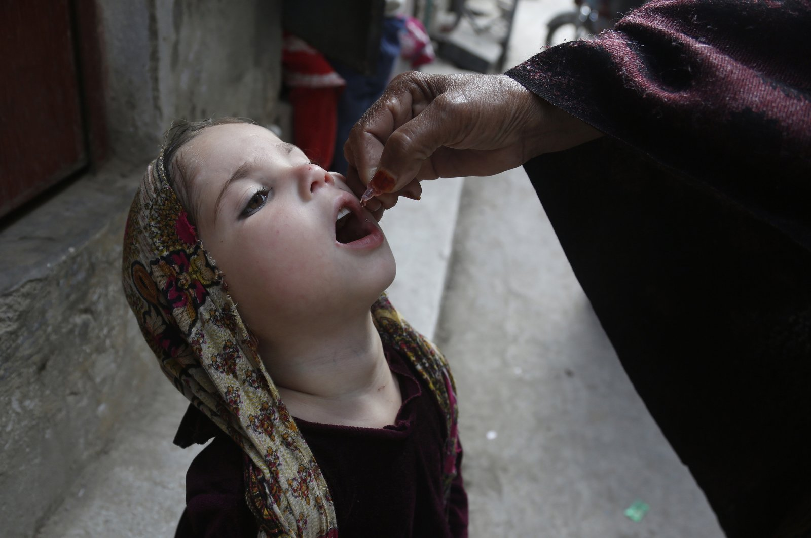 A health worker gives a polio vaccine to a child in Lahore, Pakistan, Monday, March 16, 2020. (AP Photo)