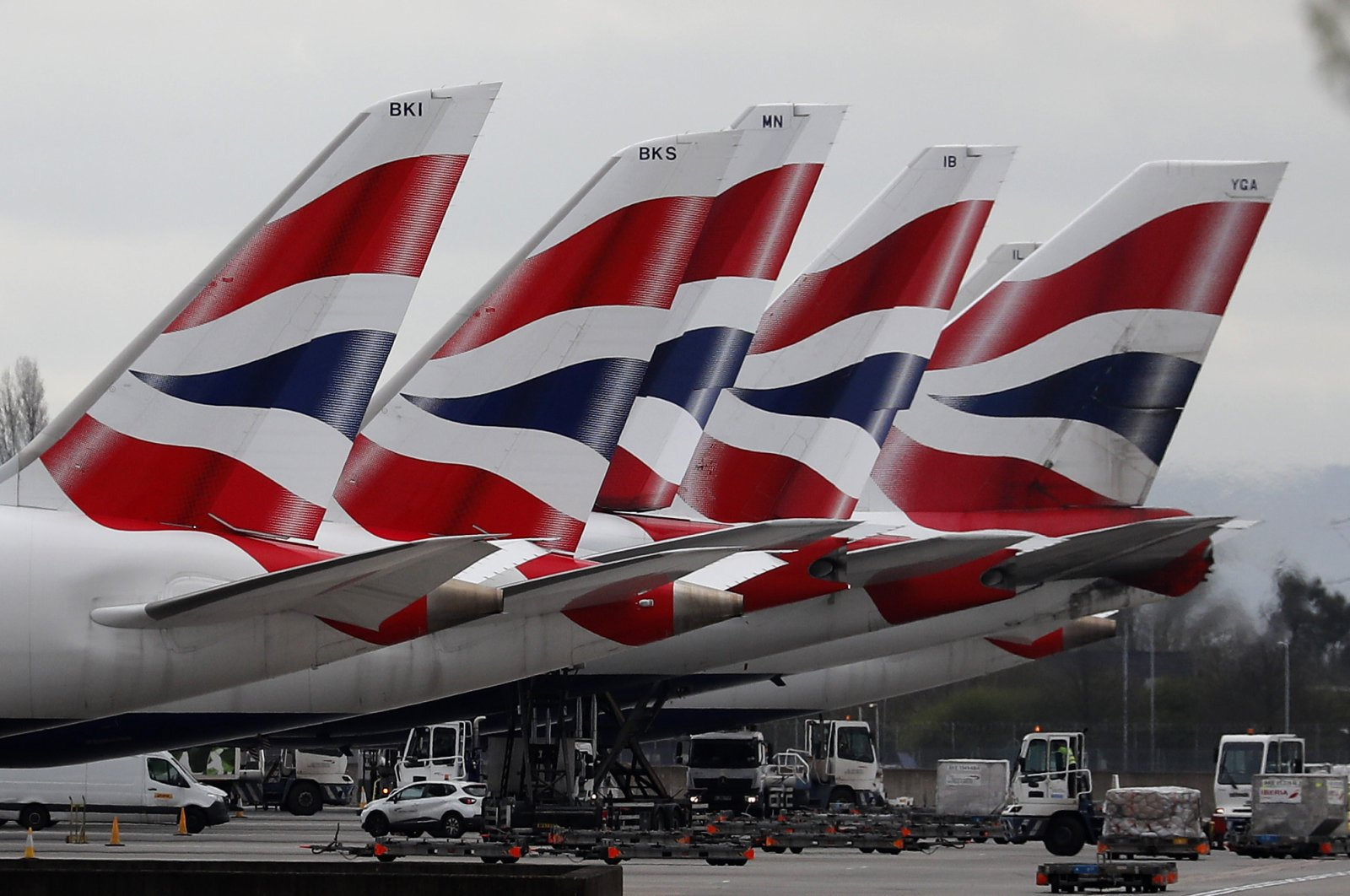 British Airways planes are seen parked at Terminal 5 at Heathrow Airport in London, Britain, March 18, 2020. (AP Photo)