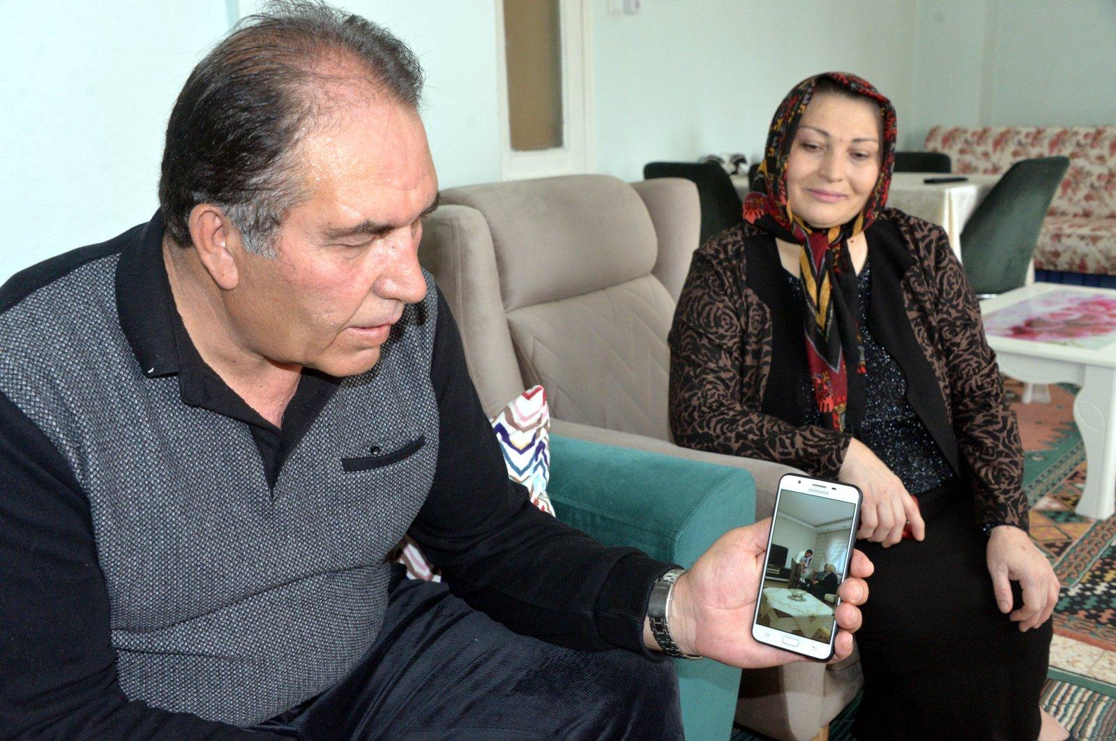 Rüştü Çınkır (L) watches his son as he puts on engagement ring, in Kahramanmaraş, Turkey, Wednesday, April 1, 2020. (DHA Photo)