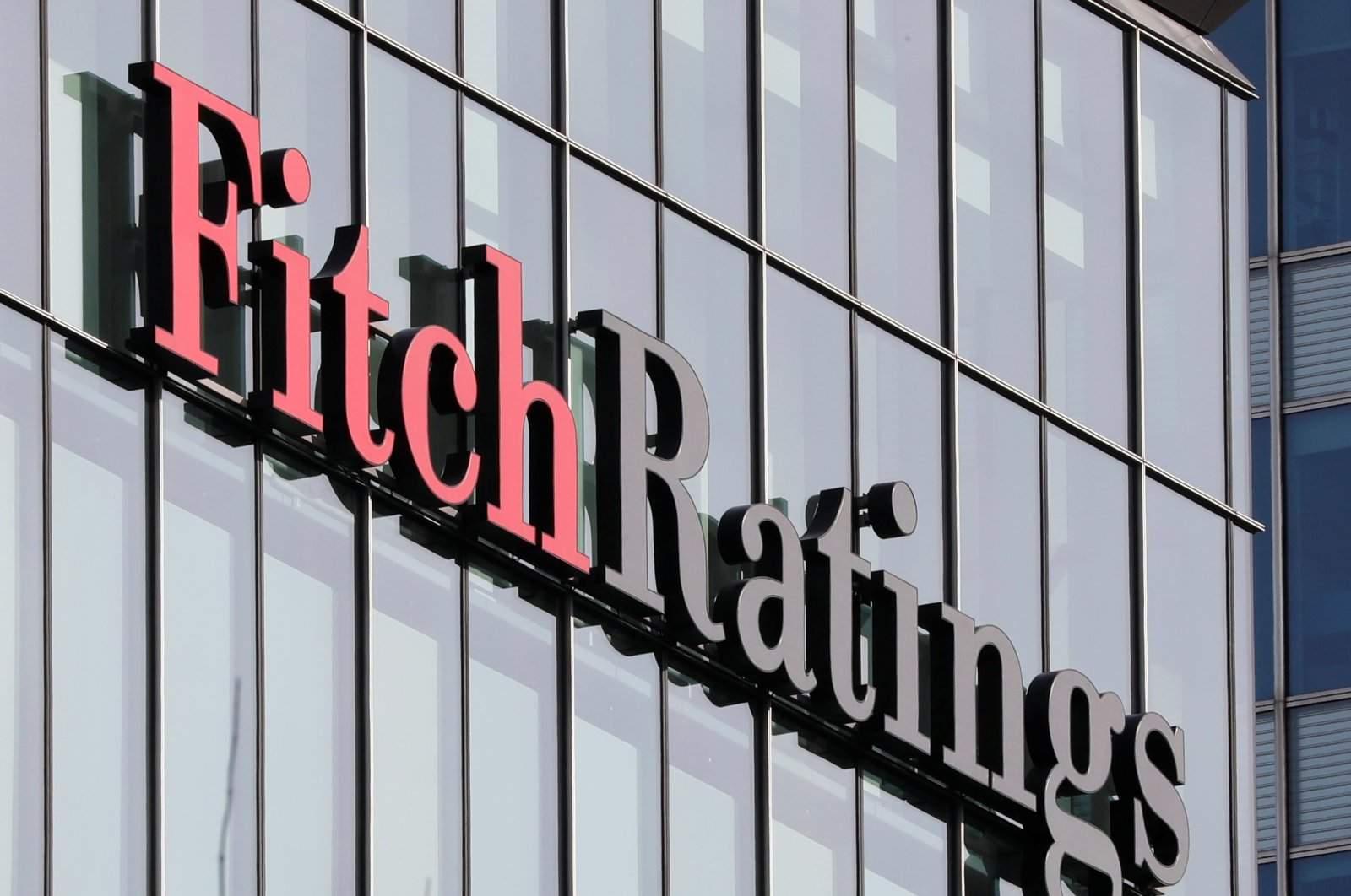 The Fitch Ratings logo is seen at their offices in the Canary Wharf financial district in London, Britain, March 3, 2016. (Reuters Photo)