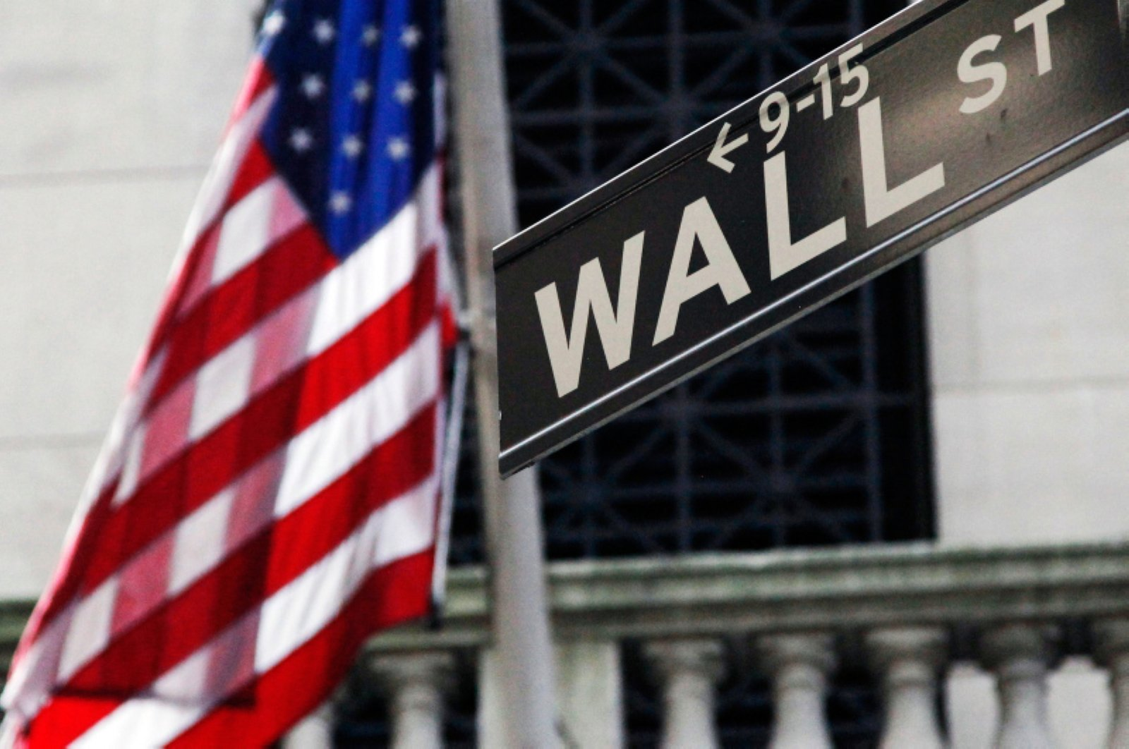 This Monday, July 15, 2013, file photo shows the American flag and Wall Street sign outside the New York Stock Exchange. (AP Photo)
