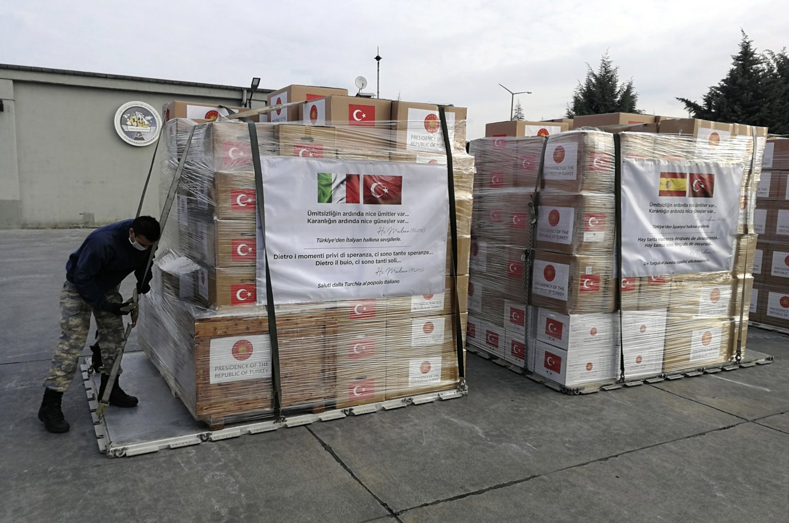 A soldier prepares to load a military cargo plane with Personal Protection Equipment heading to Italy and Spain to help the countries combat the new coronavirus outbreak, in Ankara, Turkey, Wednesday, April 1, 2020. (AP)