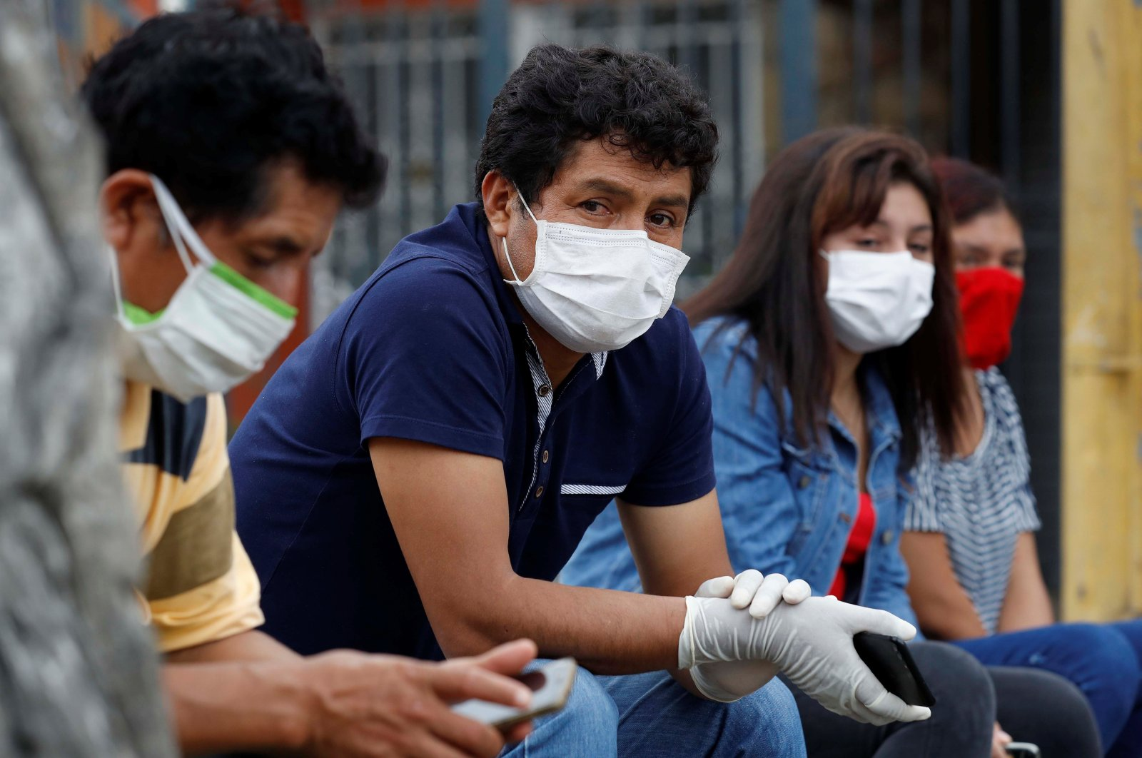 People with symptoms of COVID-19 are waiting to be tested in a tent installed outside the Casimiro Ulloa emergency hospital in Lima, Peru, April 1, 2020. (EPA Photo)