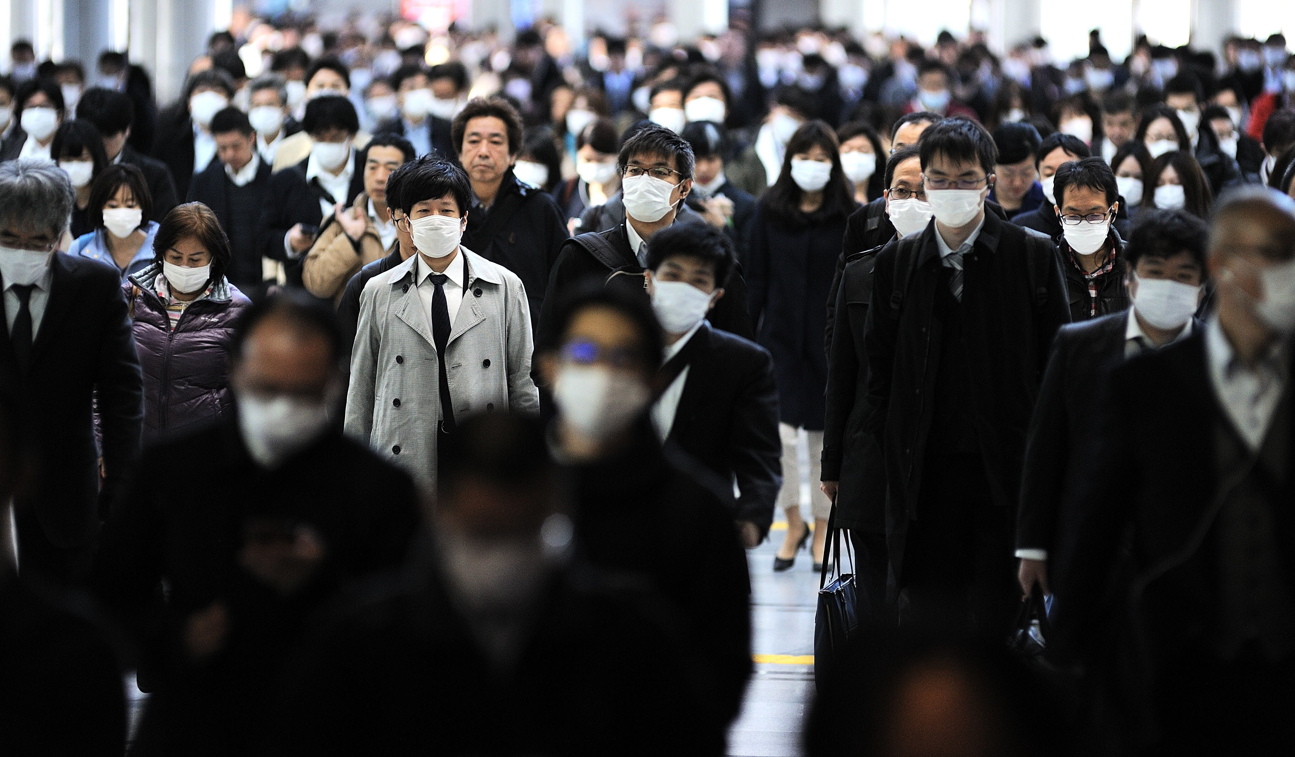 Despite calls to stay home, many Japanese donning masks fill the streets of Tokyo during rush hour as seen in this photo taken on Thursday, April 02, 2020. (AA Photo)