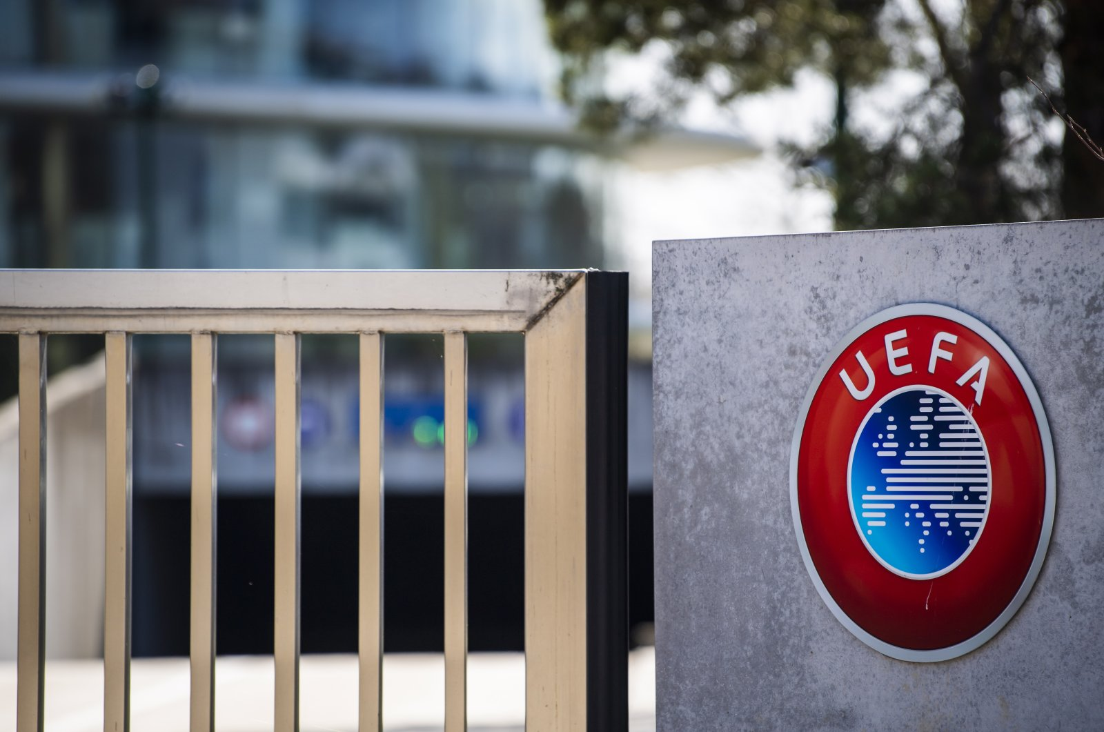 The UEFA logo is pictured at the entrance of the UEFA headquarters in Nyon, Switzerland, March 17, 2020. (EPA Photo)