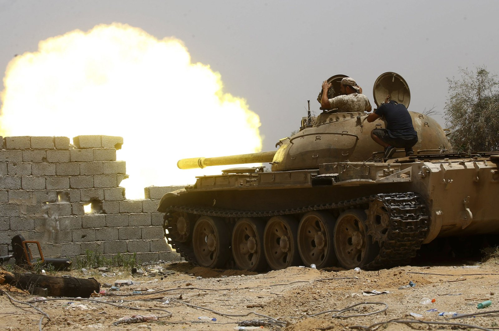 Forces loyal to the UN-recognised Government of National Accord (GNA) open tank fire from their position in the al-Sawani area south of the Libyan capital Tripoli during clashes with Haftar forces, June 13, 2019. (AFP)