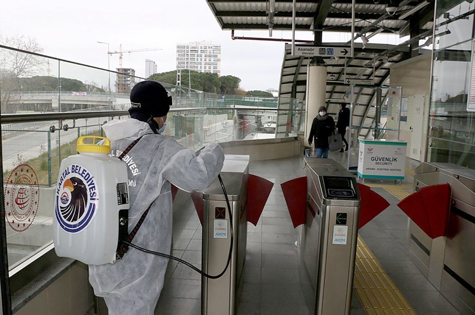 An Istanbul municipal worker disinfects a metro station in Kartal district for the second time as part of measures to contain the coronavirus (AA Photo)