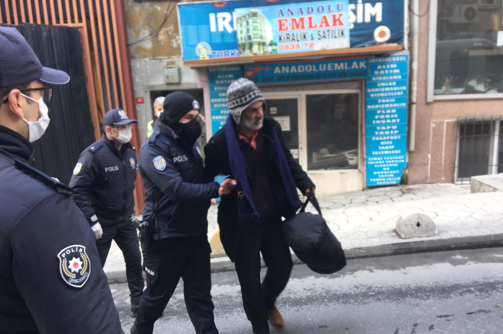 Police escort a man who reportedly fled the hospital he was taken to after being suspected of a positive case, in Beyoğlu district, Istanbul, Turkey, Friday, April 3, 2020. (DHA Photo)