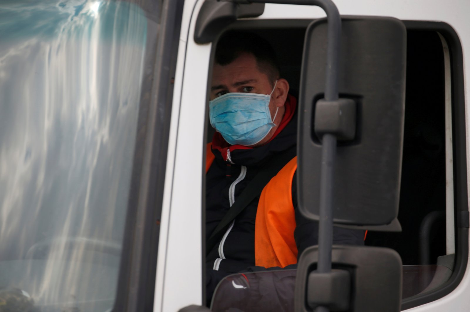 A truck driver wearing a protective face mask arrives at the Amazon logistics center in Lauwin-Planque, northern France, March 19, 2020. (Reuters Photo)
