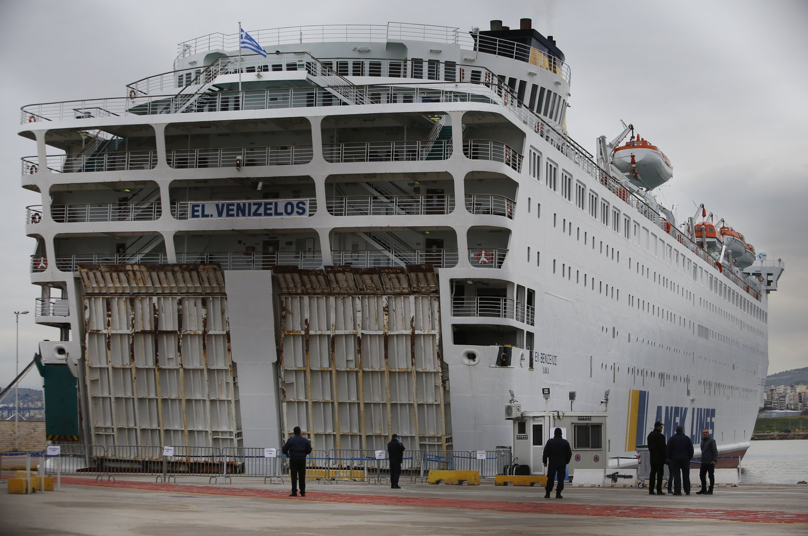 Police officers and health officials wait outside the ship, in the port of Piraeus, Greece, Friday, April 3, 2020. (AP Photo)