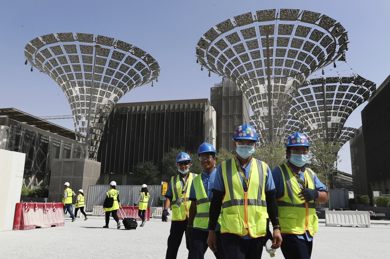 In this Oct. 8, 2019 file photo, technicians walk at the under construction site of the Expo 2020 in Dubai, United Arab Emirates. (AP Photo)