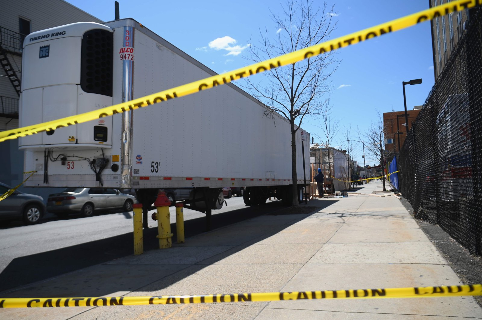 In this file photo taken on April 02, 2020, refrigerated trailers are parked outside of the Wyckoff Heights Medical Center in Brooklyn on April 02, 2020, in New York. (AFP Photo)
