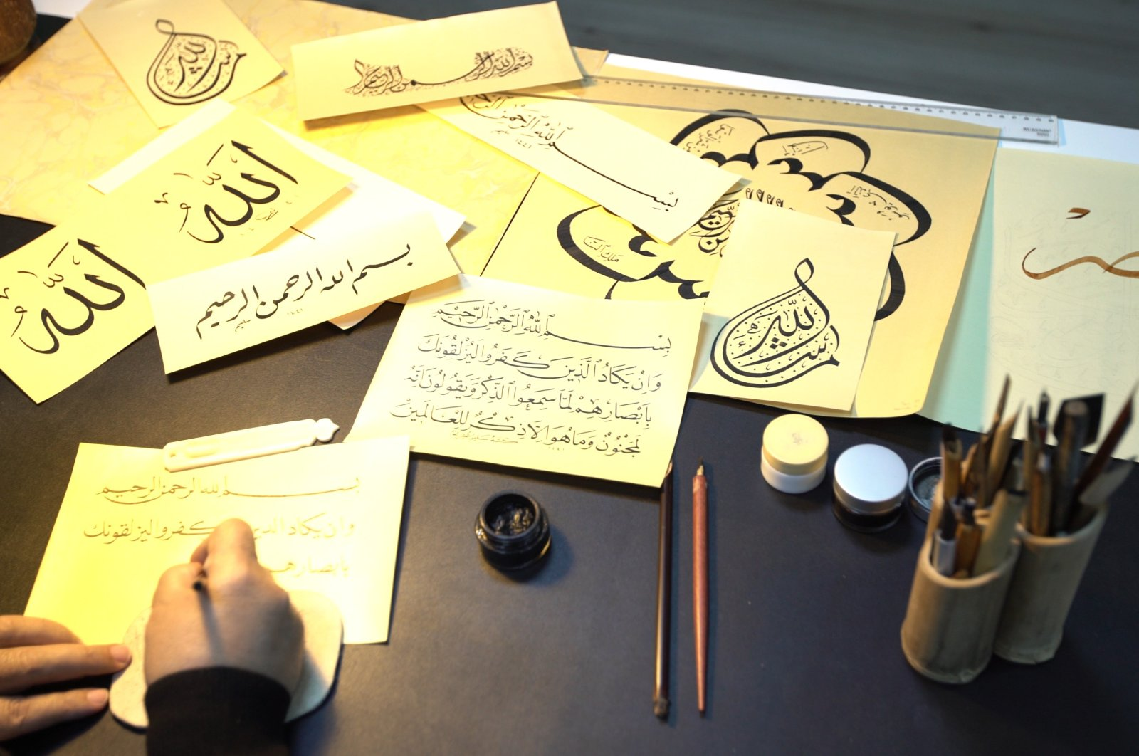 Islamic calligraphy is the artistic practice of handwriting and calligraphy based upon the alphabet in the lands sharing a common Islamic cultural heritage. (İHA Photo)