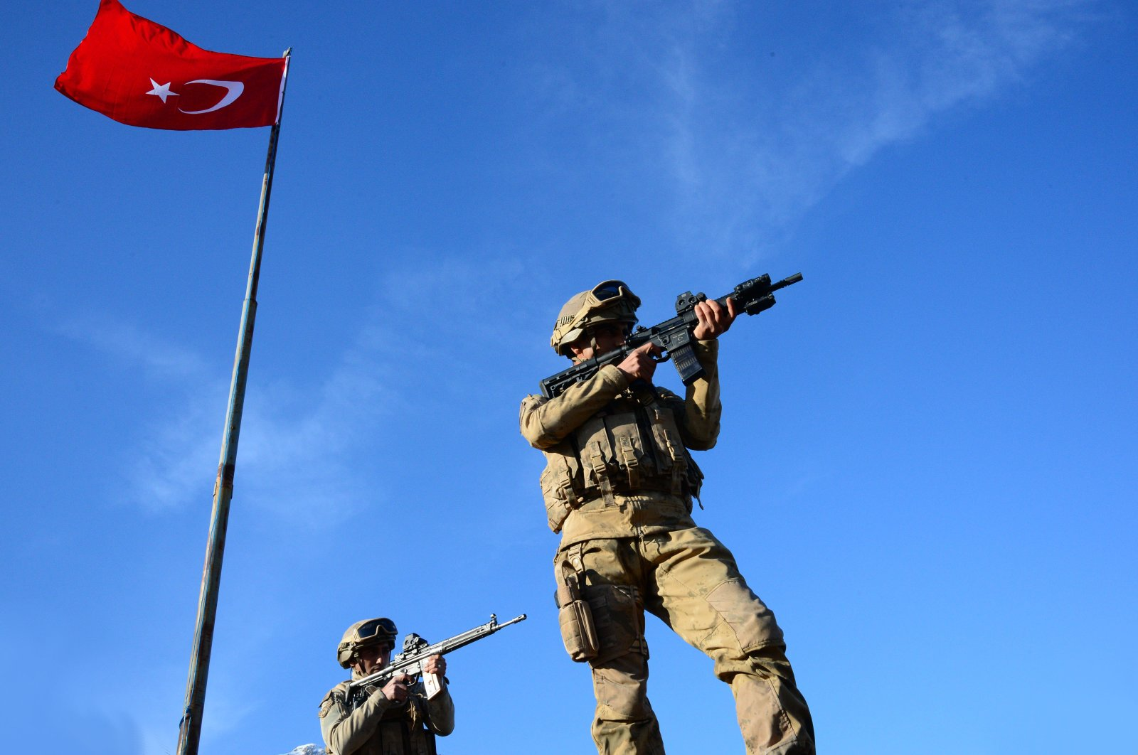 This photo taken March 19, 2020, shows members of the Turkish Armed Forces (TSK) next to a Turkish flag. The TSK has dealt a heavy blow to terrorist organizations with domestic and cross-border anti-terror operations in March. (AA Photo)