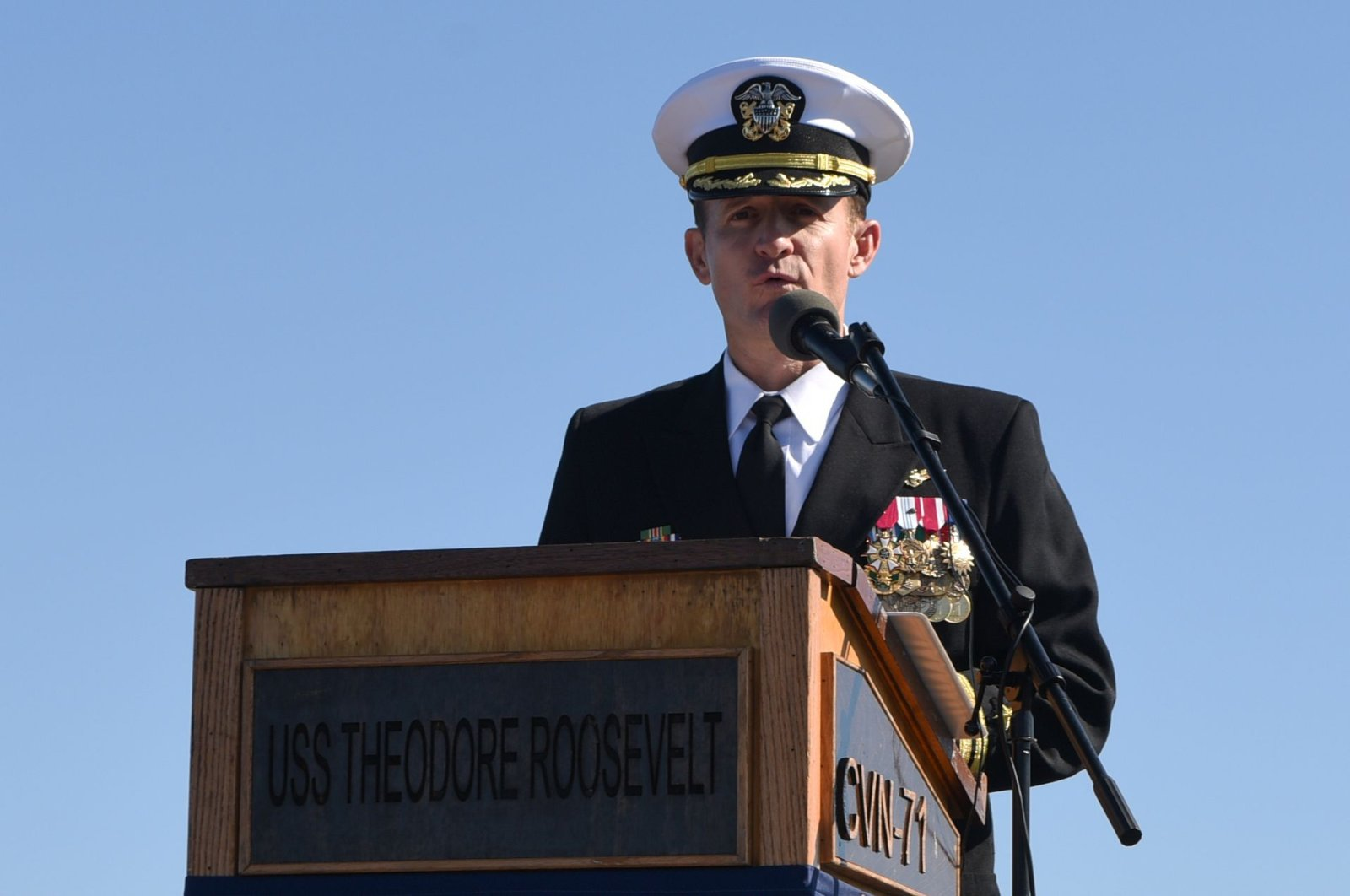 This handout photo released by the U.S. Navy shows Capt. Brett Crozier addressing the crew for the first time as commanding officer of the aircraft carrier USS Theodore Roosevelt (CVN 71) during a change of command ceremony on the ship's flight deck in San Diego, California, Nov. 1, 2019. (AFP Photo)