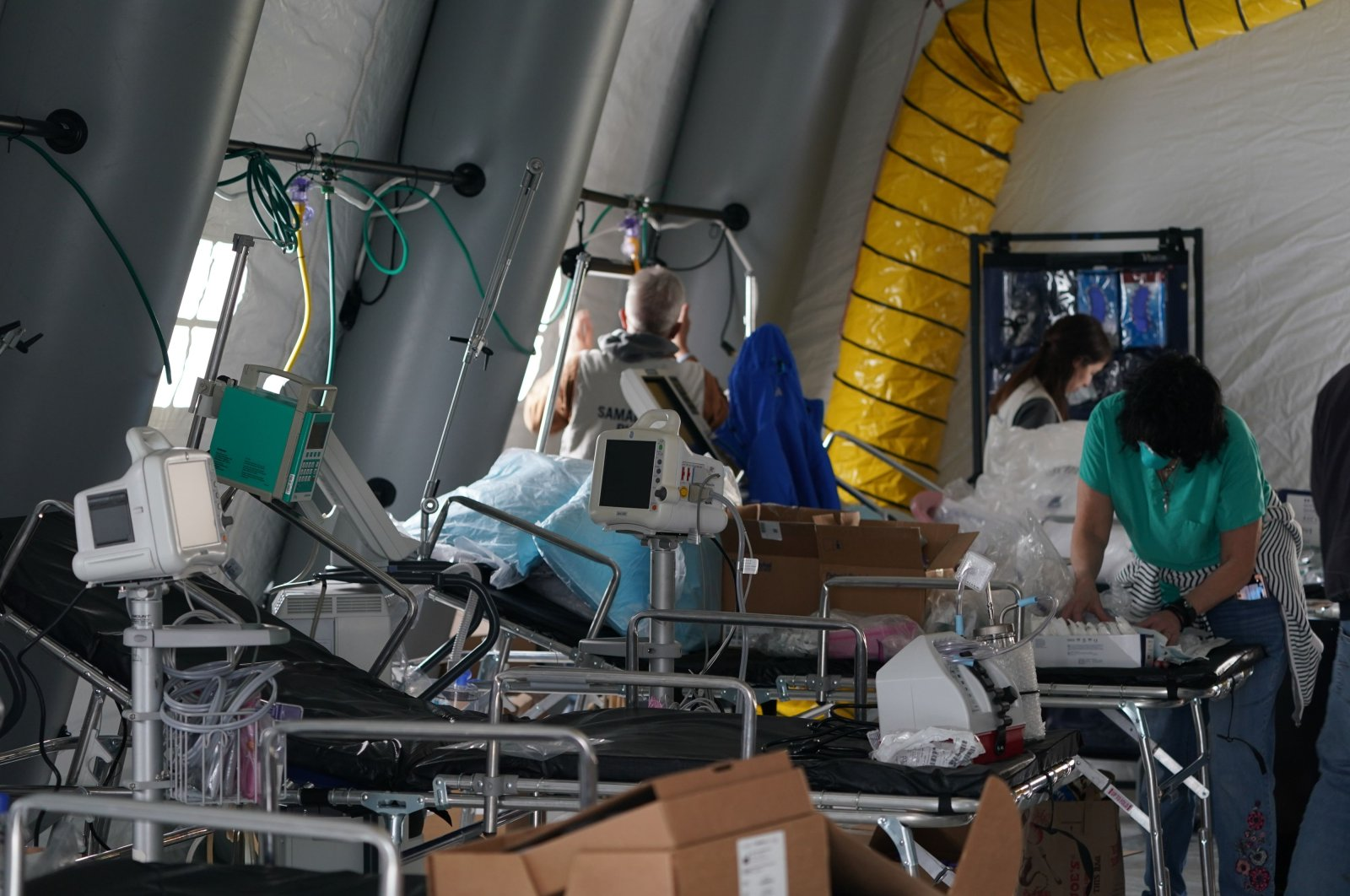 Medical supplies and beds are seen inside a tent as volunteers from the international Christian relief organization Samaritan's Purse set up an Emergency Field Hospital for patients with COVID-19 in Central Park across Fifth Avenue from Mt. Sinai Hospital on Monday, March 30, 2020, in New York, U.S. (AP Photo)