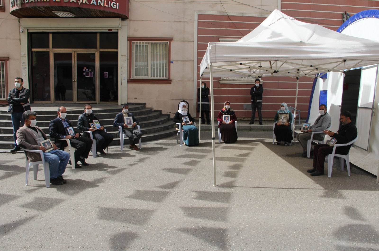 Families, protesting the abduction of their children by the PKK, continue their sit-in for the 217th day despite the coronavirus pandemic, Diyarbakır, Turkey, Monday, April 6, 2020. (IHA Photo)