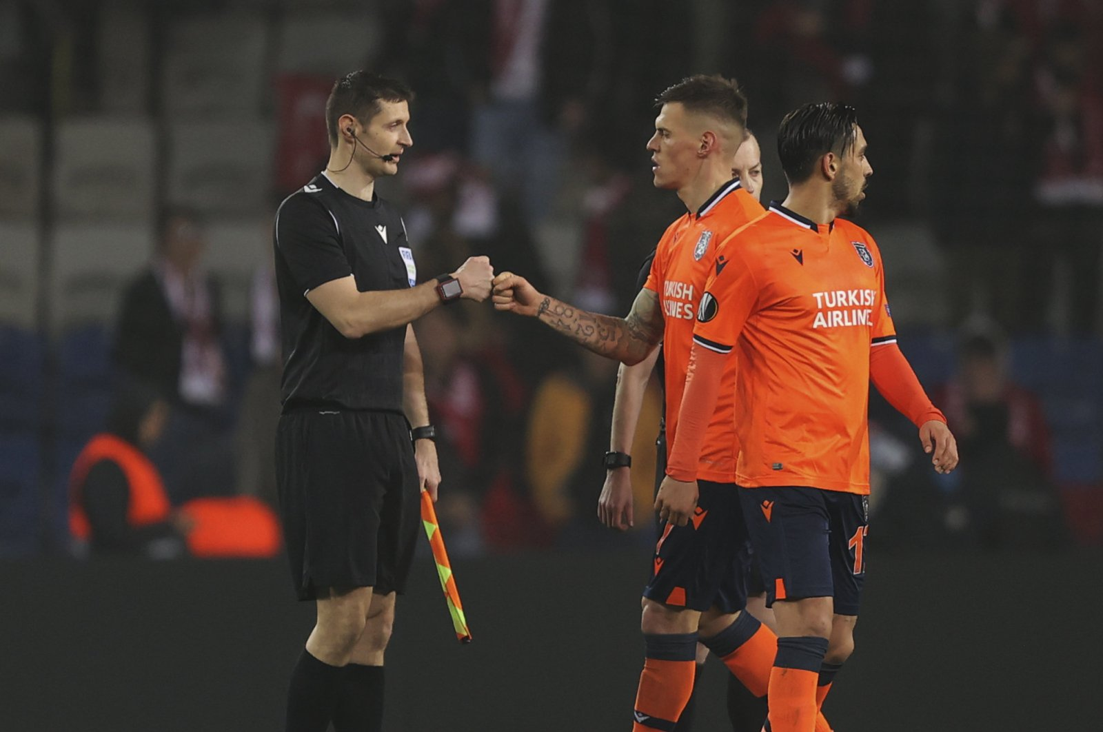 A Medipol Başakşehir player fist bumps the referee instead of a traditional handshake, Istanbul, Turkey, March 12, 2020. (AP Photo)