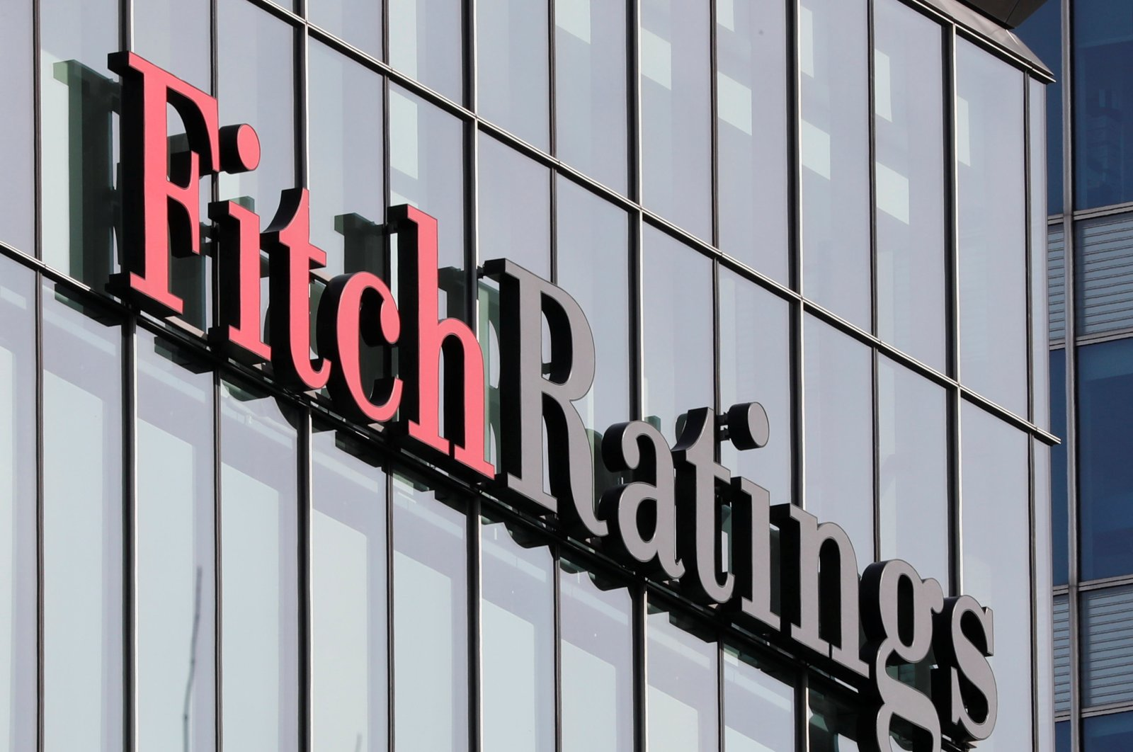 The Fitch Ratings logo is seen at their offices at Canary Wharf financial district in London, Britain, March 3, 2016. (Reuters Photo)