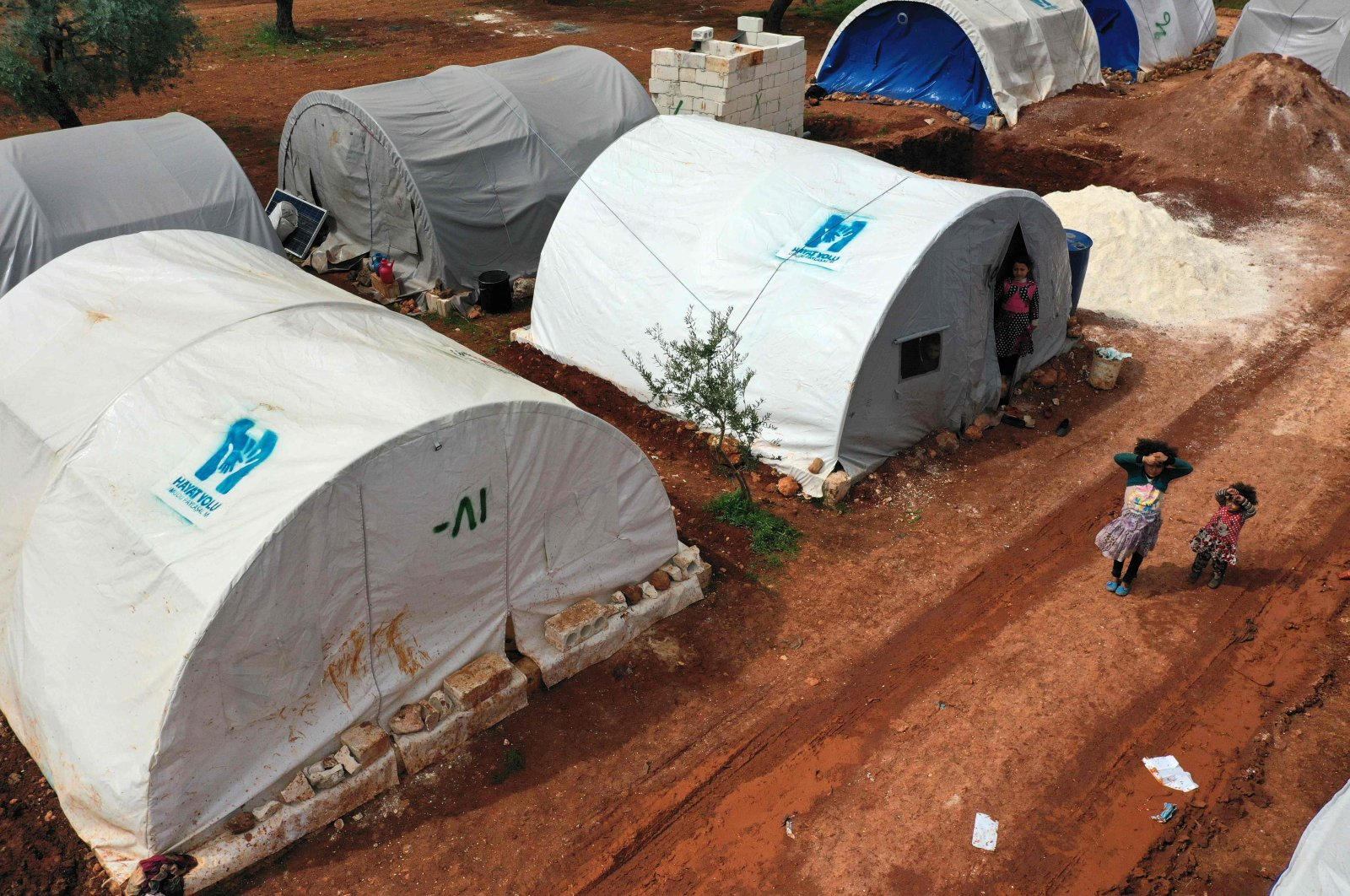 An aerial view of a camp for displaced Syrians from Idlib and Aleppo provinces, near the town of Maaret Misrin in Syria's northwestern Idlib province, Sunday, April 5, 2020 . (AFP)
