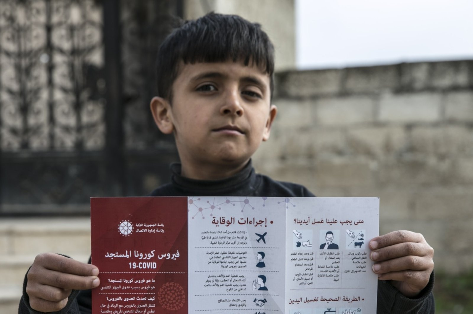Informational brochures prepared by the Turkish Presidency's Communications Directorate informing locals in Syria about COVID-19 were distributed in the country's northwest, March 20, 2020. (Photo courtesy of the Communications Directorate)