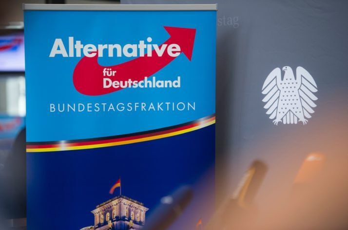 A poster with the AfD logo is pictured next to a Bundestag background banner, Berlin, Sept. 26, 2017. (AFP Photo)