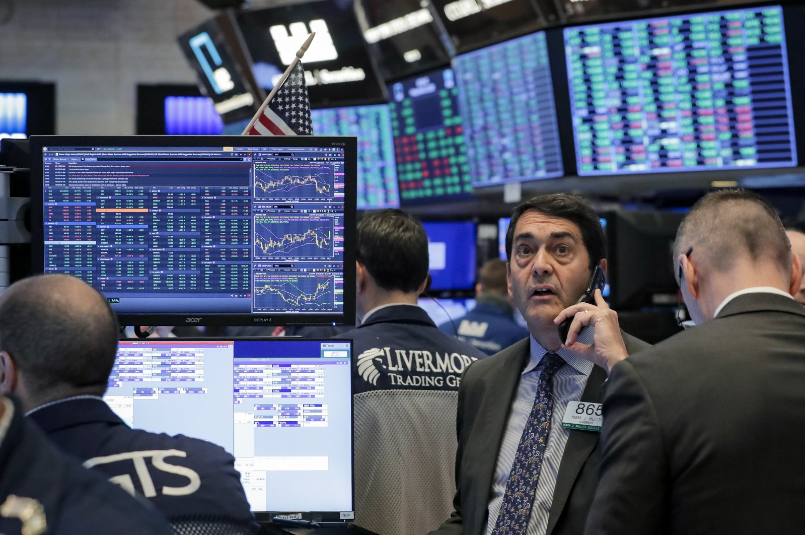 Traders work on the floor of the New York Stock Exchange in New York, U.S., March 20, 2020.