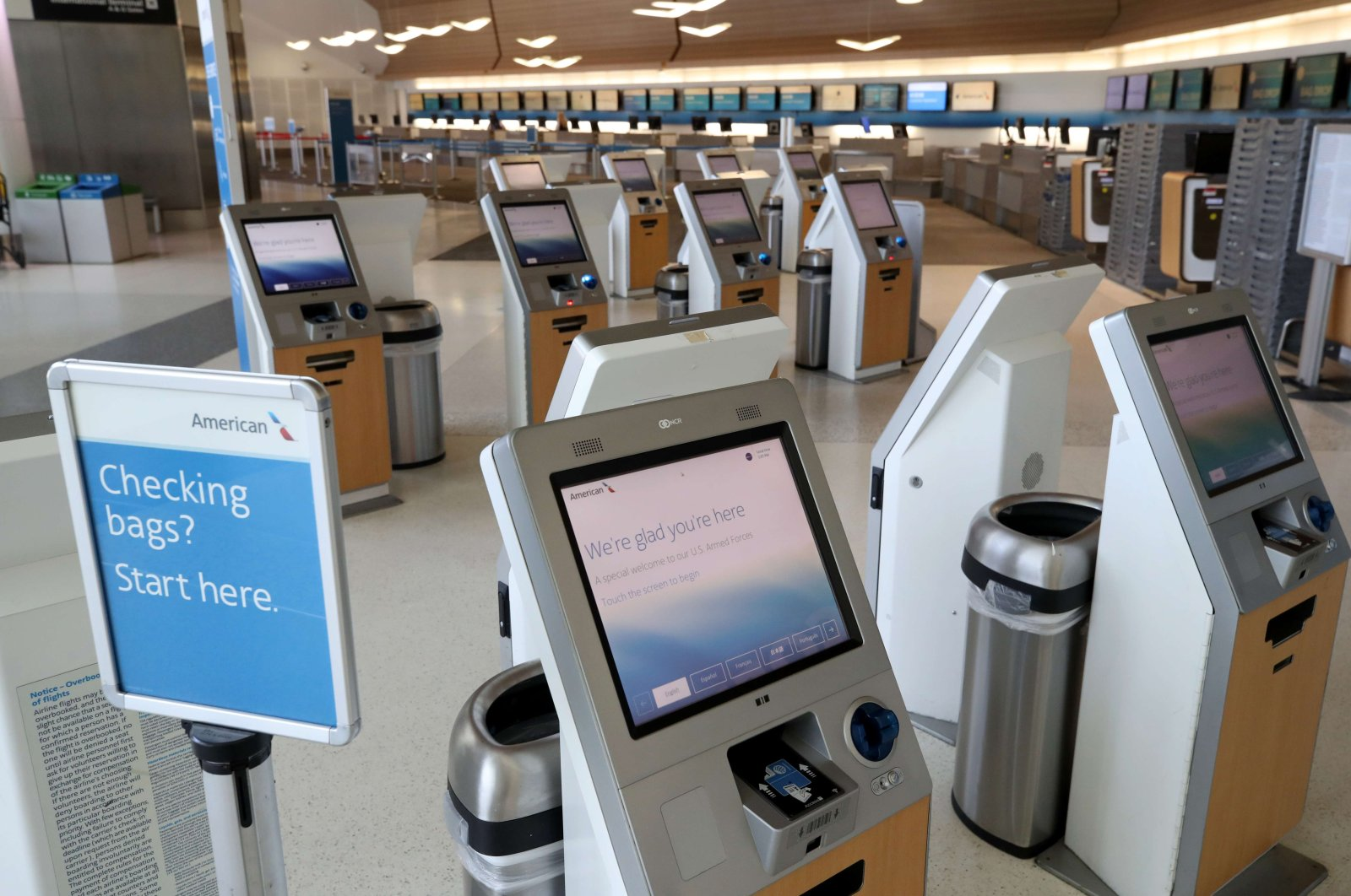 The American Airlines ticket counter sits empty at San Francisco International Airport on April 2, 2020, in San Francisco, California. Due to a reduction of flights and people traveling, San Francisco International Airport has consolidated all of its terminals into one concourse in the international terminal. (AFP Photo)