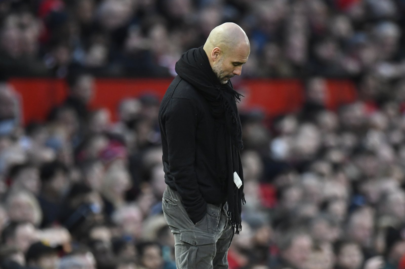 Pep Guardiola reacts during an English Premier League match, in Manchester, Britain, M between Manchester United and Manchester City held at Old Trafford in Manchester, Britain, Sunday, March 8, 2020. (EPA Photo)