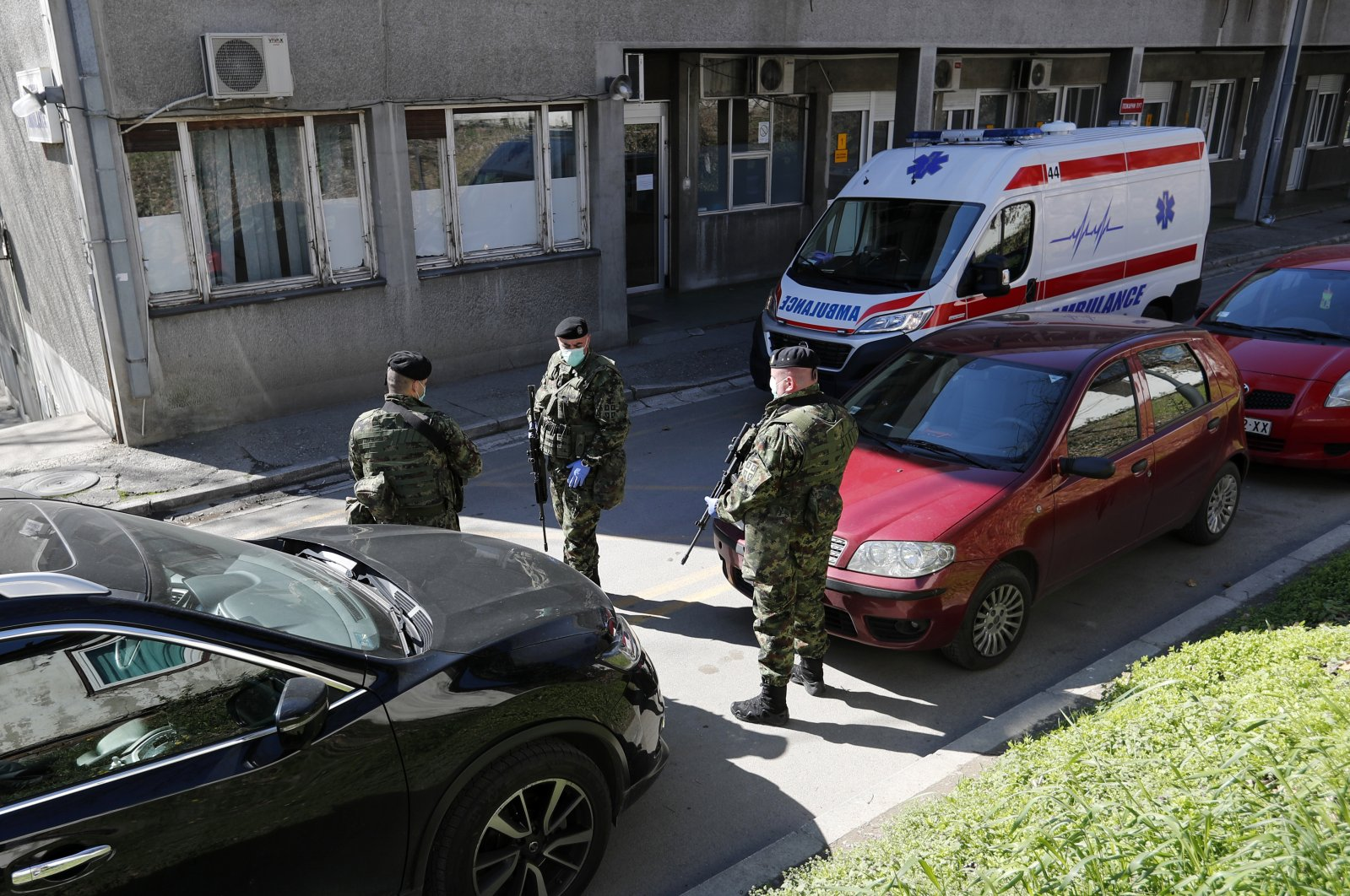 Serbian army soldiers stand guard outside the Clinic for Infectious and Tropical Diseases in Belgrade, Serbia, March 16, 2020. (AP Photo)