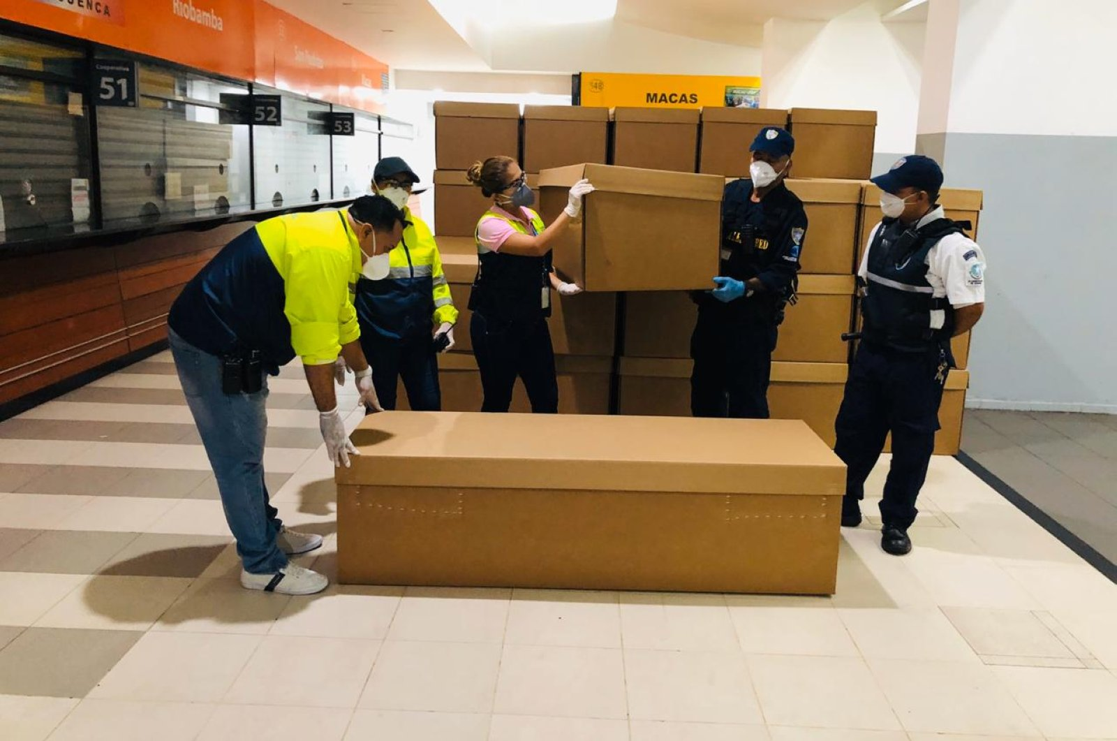 Handout picture released by Guayaquil Mayor's Office shows employees with a donation of cardboard coffins in Guayaquil, Ecuador, Sunday, April 5, 2020. (AFP Photo)