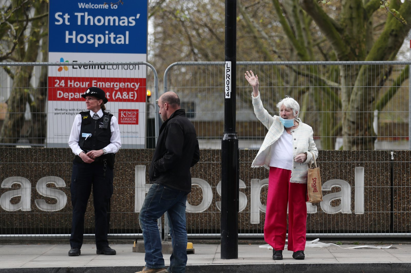 A woman wearing a protective face mask is seen outside St. Thomas' Hospital, London, U.K., Monday, April 6, 2020. (Reuters Photo)